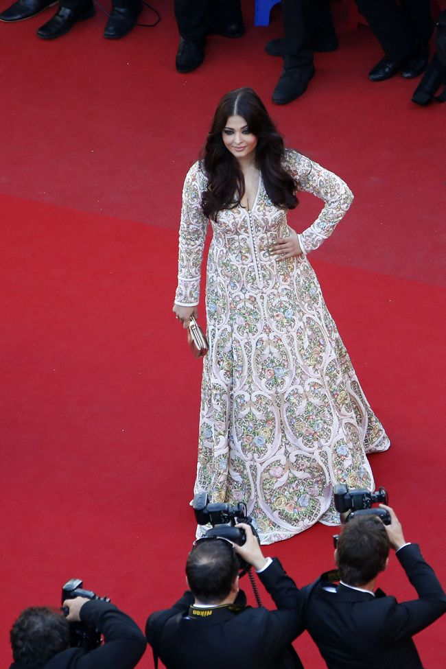 Aishwarya Rai Bachchan poses on May 20, 2013 as she arrives for the screening of the film 'Blood Ties' presented Out of Competition at the 66th edition of the Cannes Film Festival in Cannes. Cannes, one of the world's top film festivals, opened on May 15 and will climax on May 26 with awards selected by a jury headed this year by Hollywood legend Steven Spielberg.