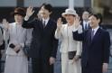 Japan's Crown Prince Naruhito, his wife Crown Princess Masako, Prince Akishino and his wife Princess Kiko wave as they see Emperor Akihito and Empress Michiko off at Tokyo's Haneda airport