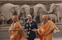 Britain's Prince Charles talks to Hindu priests as he walks inside the premises of Akshardham temple during his visit in New Delhi