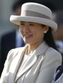 Japan's Crown Princess Masako smiles as she sees Emperor Akihito and Empress Michiko off at Tokyo's Haneda airport