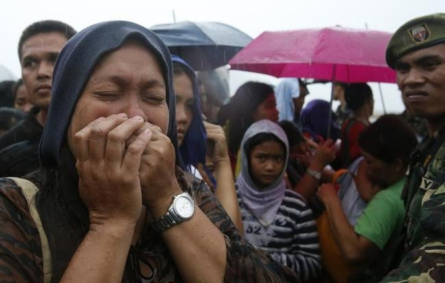 A woman cries after failing to board a military flight by the Philippine Air Force to evacuate typhoon victims in Tacloban city, which was battered by Typhoon Haiyan, in central Philippines