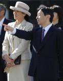 Japan's Crown Prince Naruhito talks to his wife Crown Princess Masako as they see Emperor Akihito and Empress Michiko off at Tokyo's Haneda airport