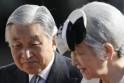 Japan's Emperor Akihito and Empress Michiko walk to board a special flight for a visit to India at Tokyo's Haneda Airport