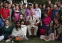 Britain's Prince Charles poses with volunteers during his visit to Navdanya Bija Vidyapeeth Farm in Dehradun