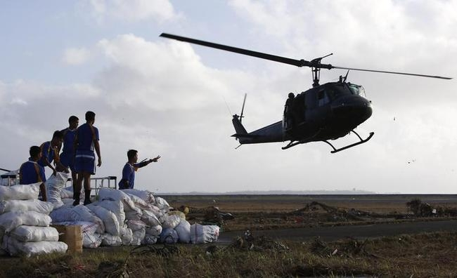 A military helicopter prepares to land to airlift relief supplies for super Typhoon Haiyan victims, in Tacloban city in central Philippines