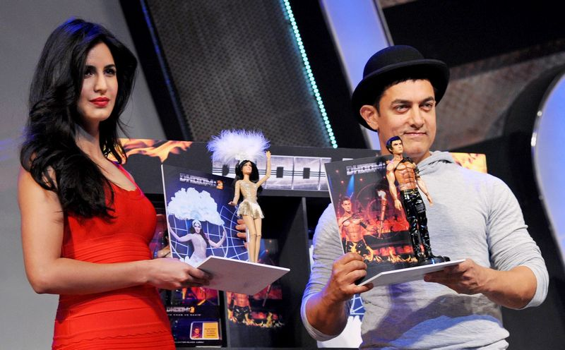 Katrina Kaif and Aamir Khan made for an interesting pair at the launch of Dhoom 3 merchandise. Photo: AFP