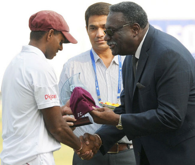 Shivnarine Chanderpaul (left) is handed his 150th Test cap by former West Indies skipper Clive Lloyd.