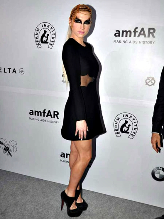 Kesha: Pop singer Kesha wore a cutaway black dress with dramatic eye make up inspired by the Black Swan. Kesha also performed at amfAR gala.