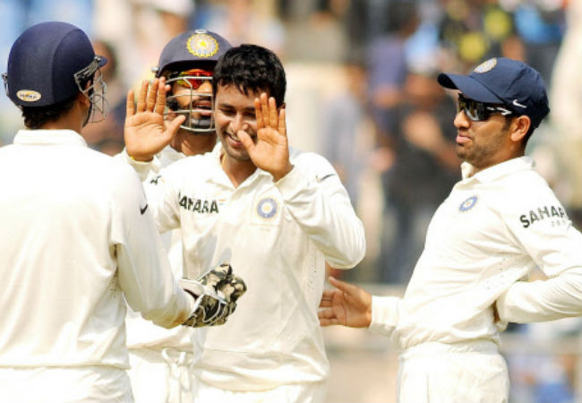 Pragyan Ojha (centre) picked up two five-wicket hauls in the Wankhede Test, recording the match figures of 10 for 89.