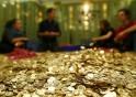 Committee members for 'Grundeinkommen' open rolls of five cent coins in the old vault of the former Schweizerische Volksbank in Basel