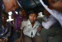 Children sit inside a police vehicle after being rescued from a sari embroidery factory in Kathmandu