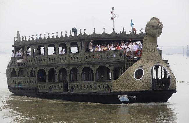 Widows, media personnel and members of a non-governmental organization travel on a boat on their way to visit the Belur temple ahead of the Durga Puja festival on the outskirts of Kolkata