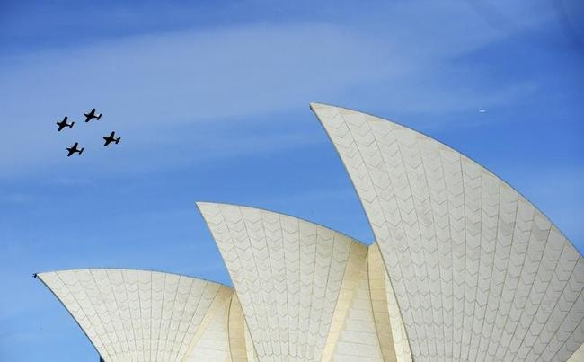 Aircraft fly past the Sydney Opera House during the International Fleet Review