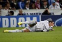 Real Madrid's Ronaldo reacts after being fouled by Juventus' Chiellini during their Champions League soccer match in Madrid