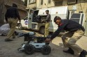 Technicians from Pakistan's top bomb disposal unit prepare their equipment during a bomb search operation in Peshawar