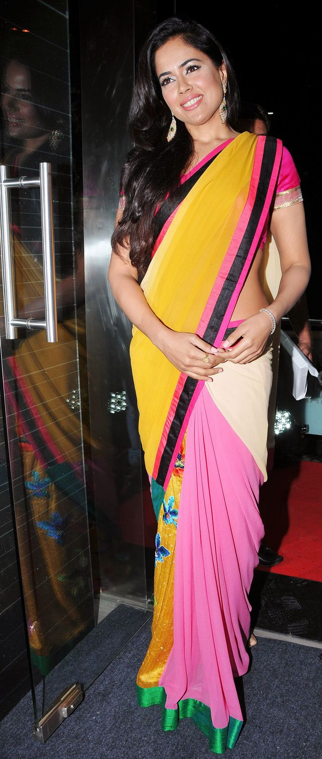 Sameera Reddy flaunted her curves in a yellow sari, which had tinge of pink in it.