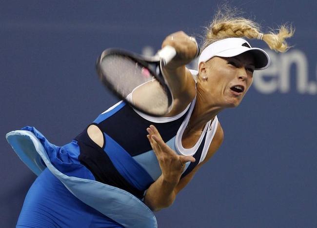 Caroline Wozniacki of Denmark serves to Camila Giorgi of Italy at the U.S. Open tennis championships in New York