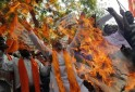 Supporters of Rashtrawadi Shiv Sena shout slogans as they burn an effigy depicting Jammu and Kashmir chief minister Abdullah during a protest against Thursday's militant attack in Jammu, in New Delhi