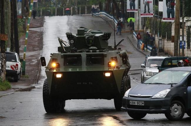 A KDF armoured military vehicle drives to the Westgate shopping centre after an exchange of gunfire inside the mall in Nairobi