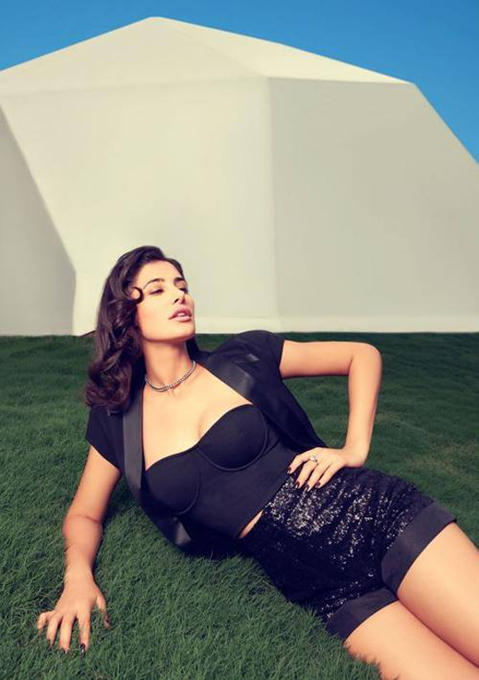 While vibrant neon shades are making it big in fashion-circles, Nargis Fakhri chooses bold black dresses for her latest Filmfare photoshoot.