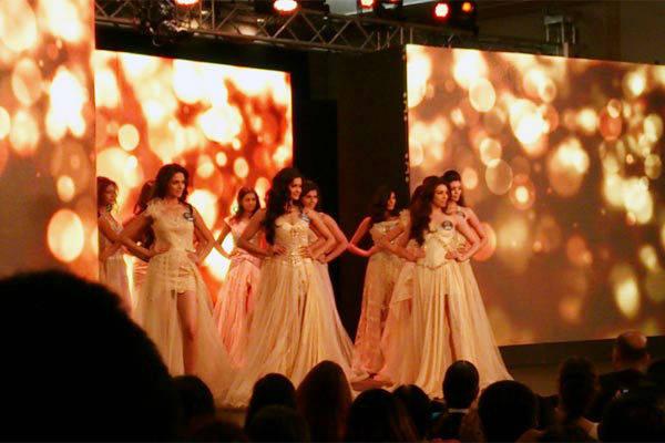 14 Miss Diva finalists in evening gowns by Mandira Wirk