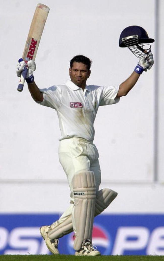 Indian ace batsman Sachin Tendulkar raises his bat after scoring a double century