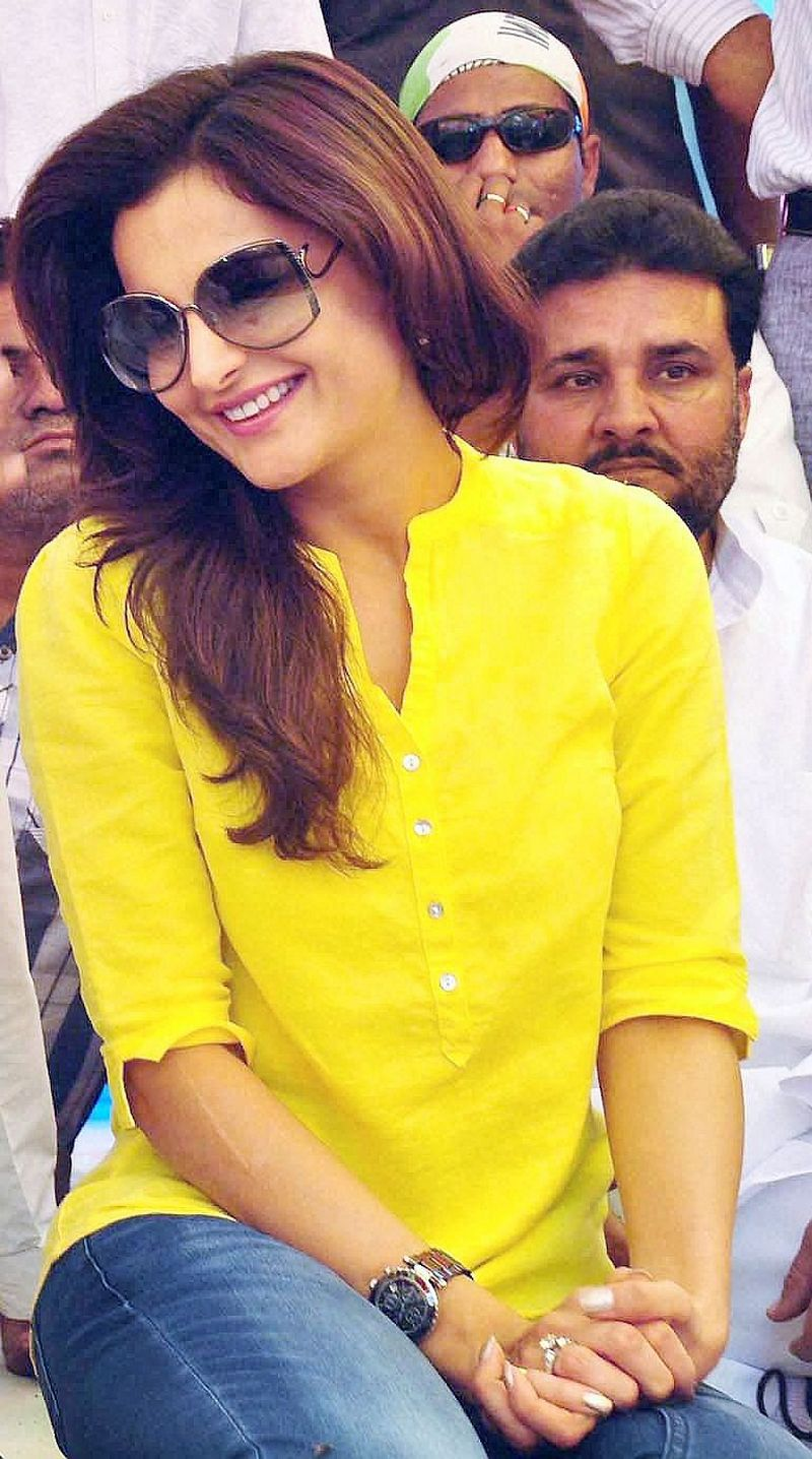 Monica Bedi wore a cheery yellow kurta while campaigning for the Congress party