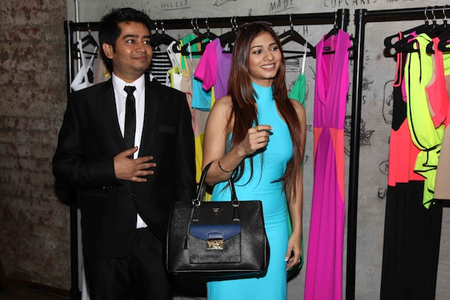 Tanishaa completed her chic look with a pair of golden peeptoes and a structured black Prada handbag.