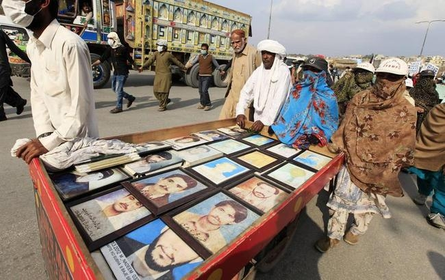 Relatives display pictures of people who have gone missing in Pakistan