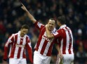 Stoke City's Charlie Adam celebrates with team mate Erik Pieters after scoring a goal against Manchester United during their English Premier League soccer match at the Britannia Stadium in Stoke-on-Trent