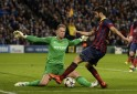 Manchester City's goalkeeper Joe Hart blocks Barcelona's Cesc Fabregas during their Champions League round of 16 first leg soccer match at the Etihad Stadium in Manchester