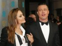 Actors Brad Pitt and Angelina Jolie arrive at the BAFTA awards ceremony at the Royal Opera House in London
