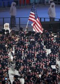 Flag-bearer Todd Lodwick of the U.S. leads his country's contingent during the opening ceremony of the 2014 Sochi Winter Olympics