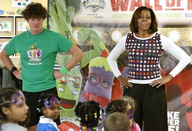 Obama and Hanson catch their breath after dancing with children at a La Petite Academy chid care center in Bowie, Maryland