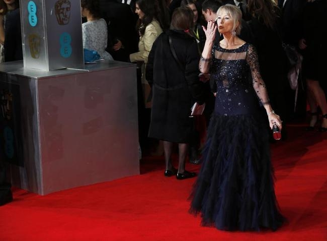 Helen Mirren blows a kiss as she arrives at the British Academy of Film and Arts awards ceremony at the Royal Opera House in London