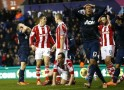 Manchester United's Cleverley reacts after a missed opportunity during their English Premier League soccer match against Stoke City at the Britannia Stadium in Stoke-on-Trent