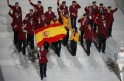 Spain's flag-bearer Javier Fernandez leads his country's contingent