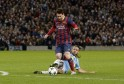 Manchester City's Martin Demichelis fouls Barcelona's Lionel Messi to concede a penalty during their Champions League round of 16 first leg soccer match at the Etihad Stadium in Manchester