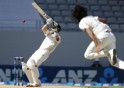 New Zealand's Boult clips away the ball from India's Sharma on day three of the first international test cricket match at Eden Park in Auckland