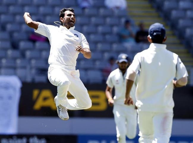 India's Mohammed Shami celebrates dismissing New Zealand's Cory Anderson on day three of the first international test cricket match at Eden Park in Auckland