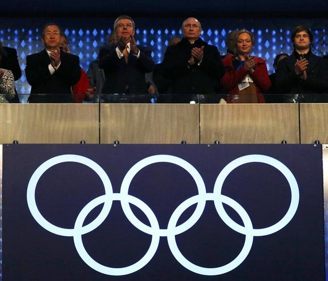Ki-moon,Thomas Bach and Putin applaud during the opening ceremony of the 2014 Sochi Winter Olympics