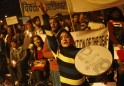 A woman shouts slogans during a candle light vigil in New Delhi