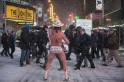 Robert Burck, also known as the original 'Naked Cowboy,' performs in a snow storm on the streets of Times Square, New York