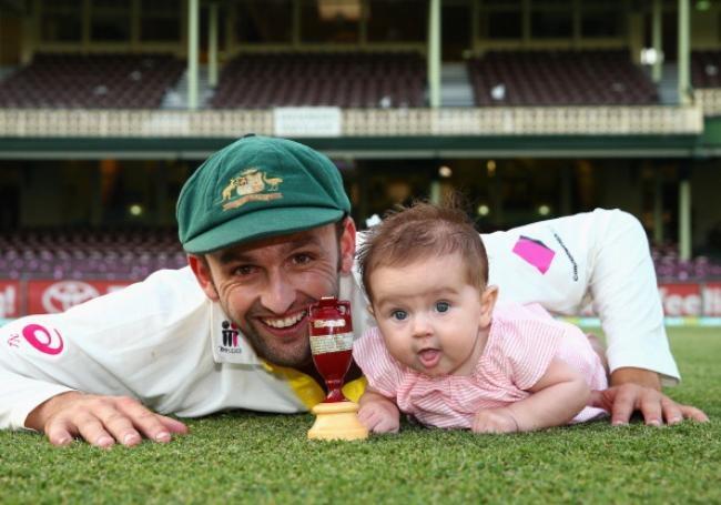 Nathan Lyon and his daughter Harper