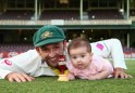 Nathan Lyon and his daughter Harper