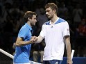 Gilles Simon of France shakes hands with Daniel Brands of Germany after defeating him in their men