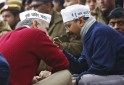 Delhi's Chief Minister Kejriwal, leader of the Aam Aadmi (Common Man) Party, speaks with Delhi's Urban Development Minister and fellow AAP leader Sisodia during a protest in New Delhi