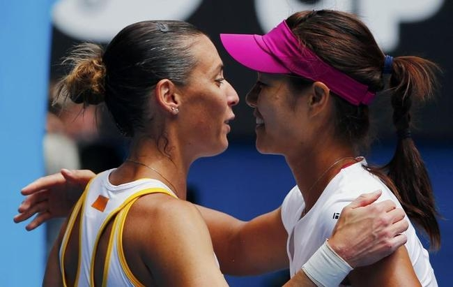 Li Na of China hugs Flavia Pennetta of Italy after winning their women
