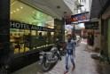 A boy walks past hotel Amax Inn, where a Danish woman was reportedly staying according to local media, in New Delhi