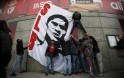 Supporters of Benfica hang a flag depicting a portrait of Eusebio at Luz stadium in Lisbon